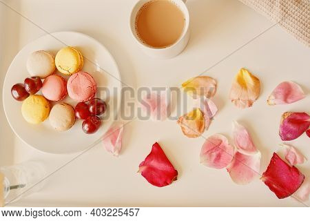 Breakfast In Bed With Macaroons. Cup Of Fragrant Coffee, Saucer With Dessert And Cherries On Table.