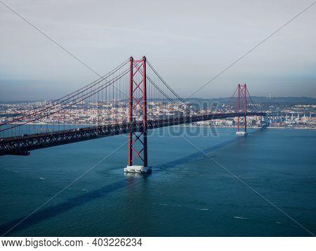 Panorama View Of Red Suspension Bridge Ponte 25 De Abril Over Tagus Tejo River Almada Lisbon Portuga
