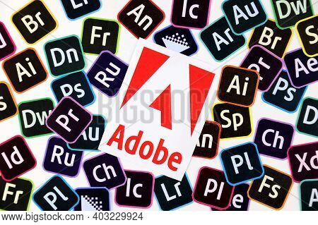 Kharkov, Ukraine - December 26, 2020: Paper Logos Of Most Popular Adobe Products On White Background