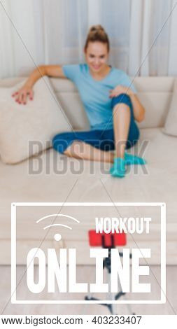 Happy Young Female Trainer Sitting On Sofa And Recording Video For Online Class, Work As A Trainer F
