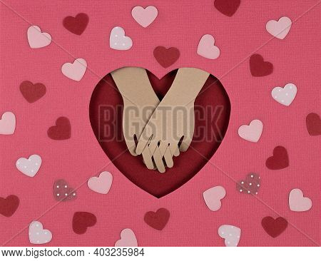 Valentines Day Card. Creative Paper Cut Background With Origami Heart And Look Of The Lovers Hands.