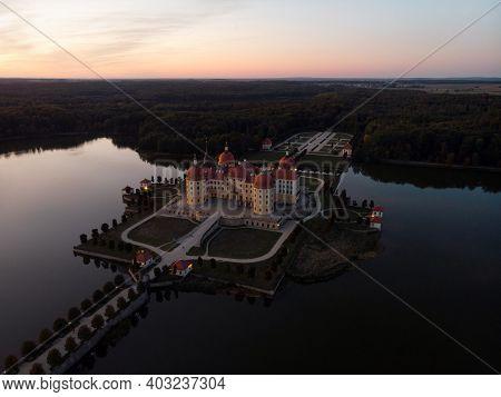 Aerial Sunset Panorama Of Schloss Moritzburg Baroque Castle On Schlossteich Lake Island In Saxony Ge