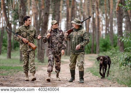 Hunting Season Happy Men With Rifles And Gun Dog.