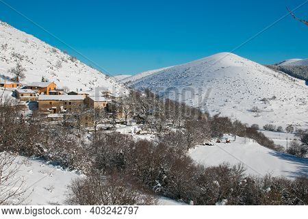 View Of Mountain Village In Pettino Mountain Covered By Snow, Umbria