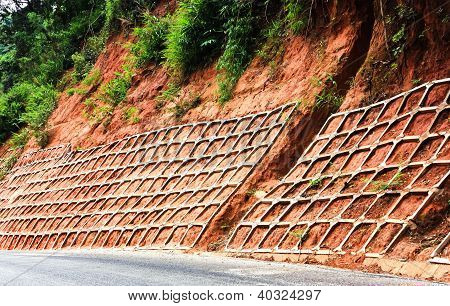 retaining wall protects mountain