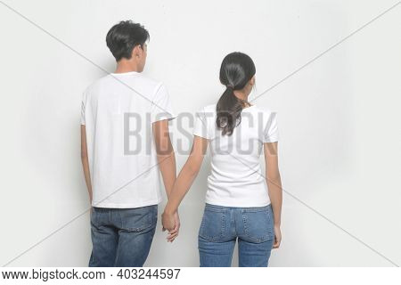 Loving couple posing on a white background. Relationship concept.back view