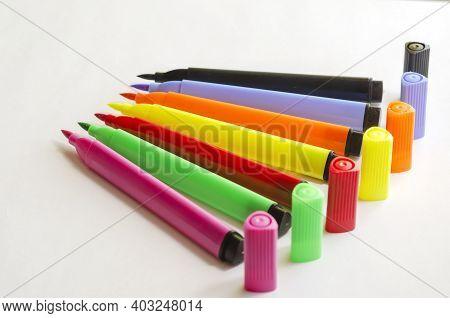 Set Of New Colorful Felt-tip Pens On White Background. Seven Brightly Colored Felt-tip Pens. Creativ