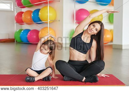 Fitness Mother And Child. Sports Activities With Children. Fitness Center. Mom And Baby Gymnastics,