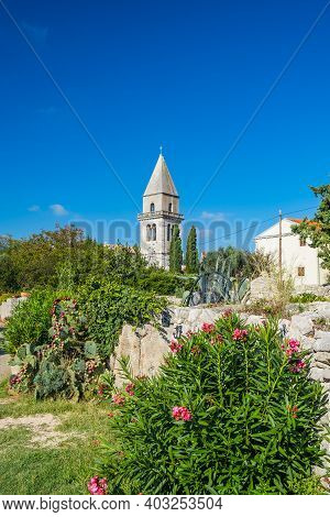Ancient Town Of Osor On The Island Of Cres In Croatia, Stone Walls And Cathedral Tower In Background