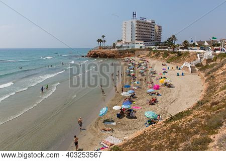 PLAYA CALA CERRADA, LA ZENIA, SPAIN-JULY 1st 2019: Beautiful summer weather attracted holidaymakers