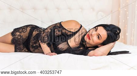 Sensual Woman In Black Lace Boudoir In Bed. Lifestyle Of Modern Elegant Lady