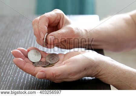Elderly Woman Counts Russian Rubles In Coins, Female Hands Close Up. Concept Of Poverty In Russia, P