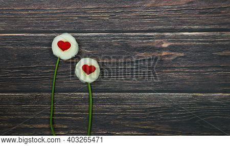 Two White Roses Flowers With Red Hearts.