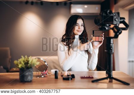 Beauty Blogger Nice Female Filming Daily Make-up Routine Tutorial On Camera. Influencer Young Woman