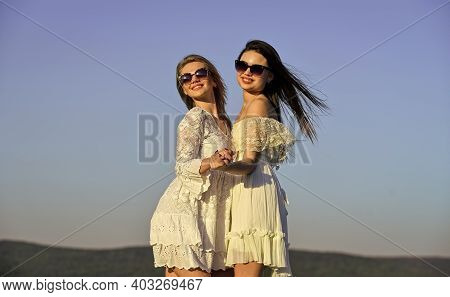 Harmony And Balance. Psychology Concept. Beautiful Women On Sunny Day Blue Sky Background. Sisterhoo