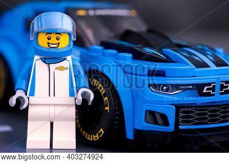 Tambov, Russian Federation - January 10, 2020 Lego Chevrolet Driver Against Lego Chevrolet Camaro Zl