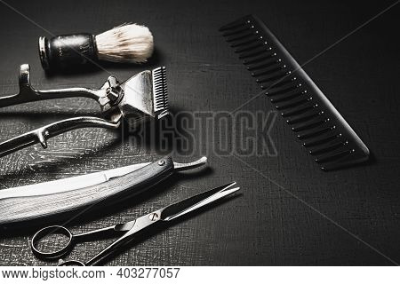 Vintage Barber Tools. Dangerous Razor, Hairdressing Scissors, Old Manual Clipper, Combs, Shaving Bru