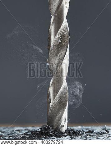 Metal Drill Bit Make Holes In Aluminum Billet On Industrial Drilling Machine With Shavings. Smoke Ri