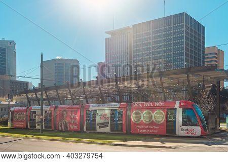 Adelaide City, South Australia - August 13, 2019: Modern Adelaidemetro Tram Crossing The Victoria Sq