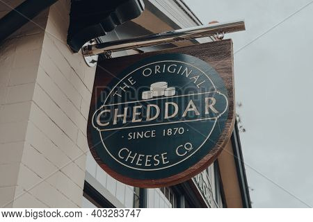 Cheddar, Uk - July 26, 2020: Sign Outside The Original Cheddar Cheese Co Shop In Cheddar, A Village