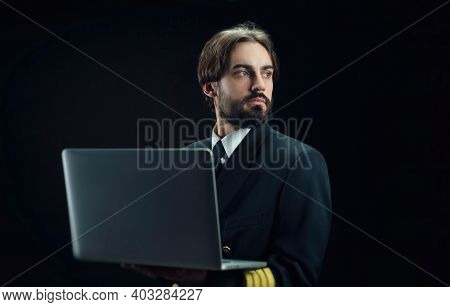 The Pilot Of The Plane Is A Man With A Beard With A Laptop