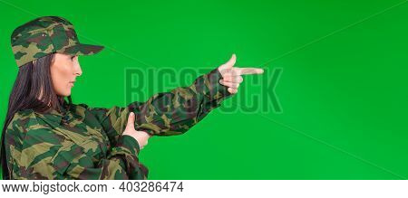 Banner- Long Format. Profile Photo Of A Woman In Military Uniform Imitates A Weapon Or Gun With Her