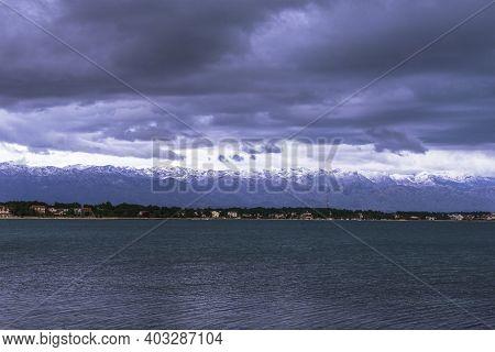 Snowy Peaks Of Velebit Mountains, Croatia. View From Vir Island.