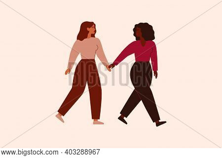 Two Strong Females Walk Together And Hold Arms. Black Woman Supports And Leads Her Friend Forward. F