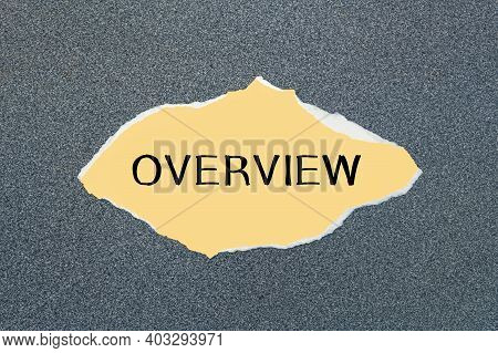 Overview- Written On Torn Yellow Paper. Gray Background