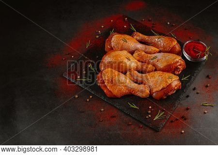 Top View.convenience Food,pree Cooked.marinated Chicken Drumstick Black Background Raw Chicken Meat