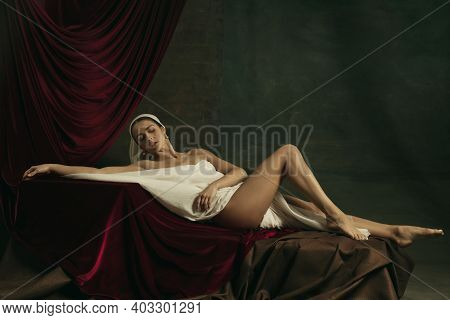 Lines. Modern Remake Of Classical Artwork - Young Medieval Woman In White Cloth On Dark Studio Backg
