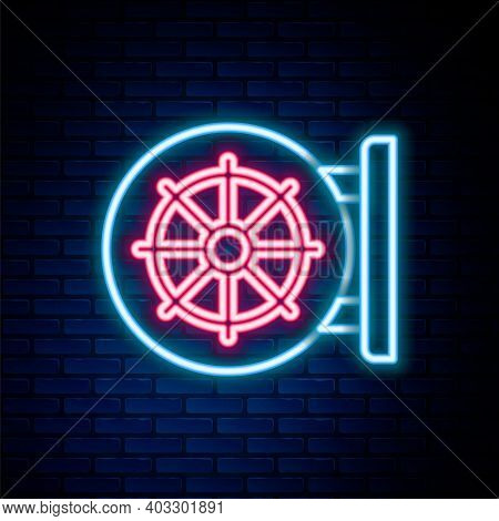 Glowing Neon Line Dharma Wheel Icon Isolated On Brick Wall Background. Buddhism Religion Sign. Dharm