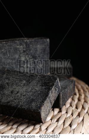 Natural Tar Soap On Wicker Pouf, Closeup