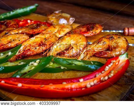Grilled Prawns With Garlic And Vegetables.shrimps Fried On A Wooden Background