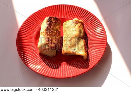 Fried Pancakes With Sour Cream Sauce On A Red Plate. Background Tree And White. Food, Russian Kitche