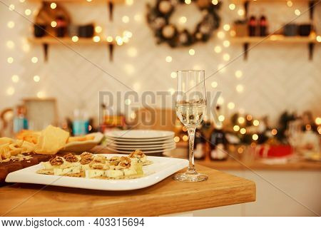 Different Kinds Of Cheeses, Wine And Snacks. Still Life On Rustic Wooden Table. French Food Tasting