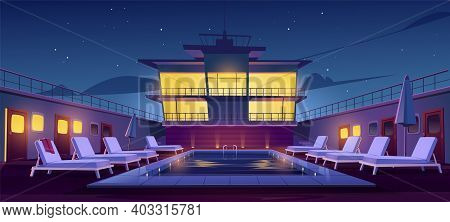 Swimming Pool On Cruise Liner At Night, Empty Ship Deck With Sun Loungers, Umbrellas And Illuminatio