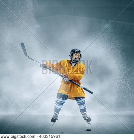 Winner. Little Hockey Player With The Stick On Ice Court And Smoke Background. Sportsboy Wearing Equ