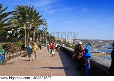 Gran Canaria, Spain - December 1, 2015: People Visit Playa Ingles Oceanfront Walkway In Maspalomas,