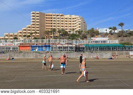 Playa Ingles, Spain - December 1, 2015: People Visit Playa Ingles Beach In Maspalomas, Gran Canaria,
