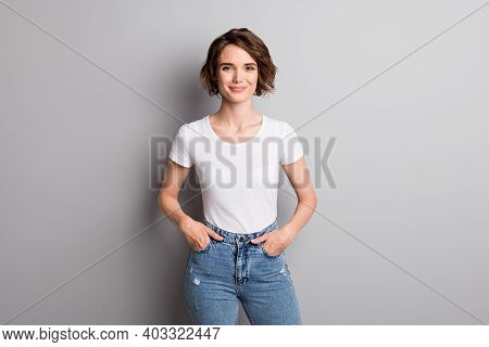 Photo Of Young Attractive Cheerful Girl Wear Casual Outfit Hands In Pocket Confident Smile Isolated