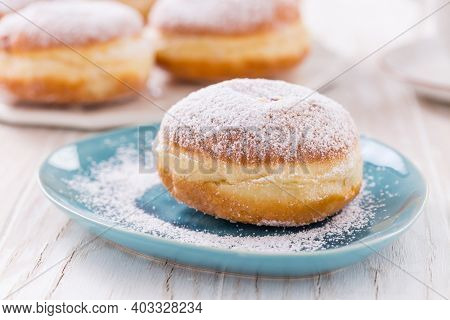 Traditional German Krapfen, Berliner or donuts with icing sugar