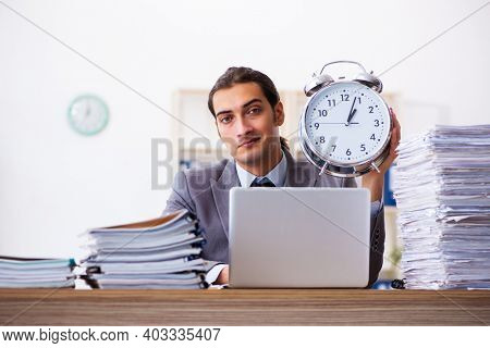 Workload male employee in time management concept