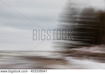 Intentional Camera Motion Photograph Of Trees On A Beach. Near Southampton, Ontario, Canada