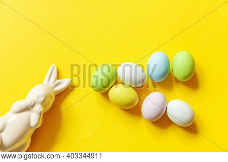 Happy Easter Concept. Preparation For Holiday. Easter Candy Chocolate Eggs Sweets And Bunny Toy Isol