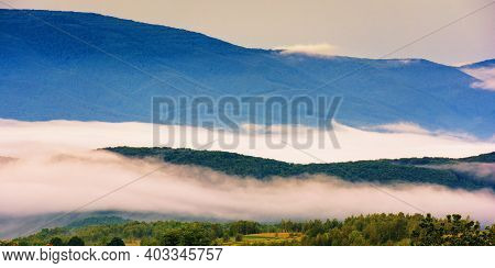 Glowing Fog In The Rural Valley At Dawn. Beautiful Mountain Landscape In Springtime. View From The H