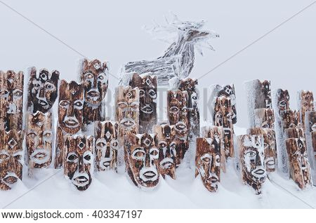 Perm Krai, Russia - January 02, 2021: Snow-covered Wooden Art Object - Group Of Idols Depicting Anth