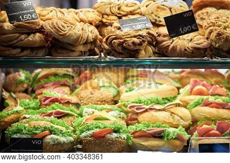 Hamburg Germany-01.02.2020: Sandwiches And Pastries Are Stuffed For Sale In A Shop Window. Display W