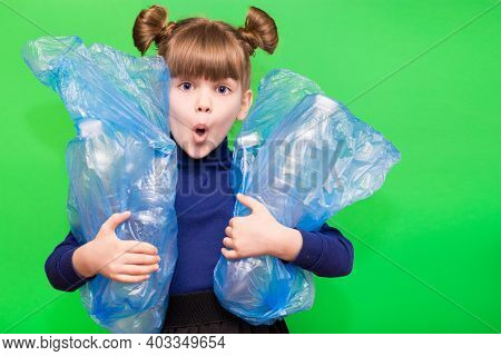 Little Ecologist Girl With Confused Funny Face Holding Trash Bags With Plastic Bottles Isolated On G