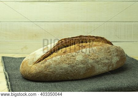 Homemade Bread In The Oven Is Simple And Tasty. Food Banner For Text Or Design. Fresh And Healthy Br